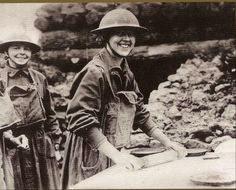 """American Salvation Army """"lassy"""" rolling pie crusts for men of the 26th Division in France, 1918."""
