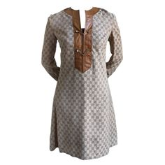 1970's GUCCI monogramed canvas tunic dress with leather trim | From a collection of rare vintage evening dresses at http://www.1stdibs.com/fashion/clothing/evening-dresses/