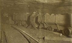 Wooden Coal Cars under ground train trips.