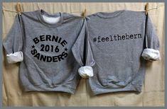BERNIE Sanders 2016. Feel the Bern hashtag on back. Funky Arched image. Bernie for President. Gray Unisex Sweatshirt. Clothing