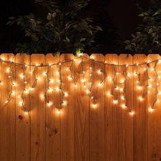 White icicle string lights along the fence - a perfect backyard party decoration!