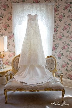 A lacy wedding dress.   Andre LaCour Photography