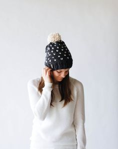 . pom pom  . seamless  . chunky slouch hat  . cozy winter accessory  . features a fair isle pattern  . made of a soft mixture of lambs wool and acrylic