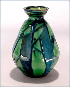 An absolutely beautiful Danish art pottery vase in teal and green with a slightly raised abstract pattern. Inside the lip are swirls of chartreuse.