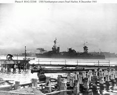 USS Northampton CA26 entering Pearl Harbor on December 8, 1941 the day after the Japanese attack. Note smoke thick in the air from ships that are still burning.