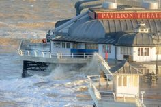 Floods. Cromer pier takes a battering from the sea on Friday morning's high tide. PHOTO: ANTONY KELLY