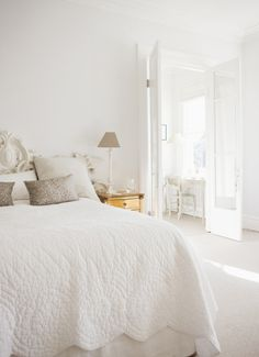 all white bedroom with pretty gold accents #bedroom
