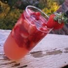 Pretty In Pink Sangria  2 (10 ounce) packages frozen sliced strawberries, thawed  1 (12 fluid ounce) can frozen lemonade concentrate, thawed  2 (750 milliliter) bottles chilled rose wine, such as white Zinfandel  2 cups pineapple juice  1 liter Fresca