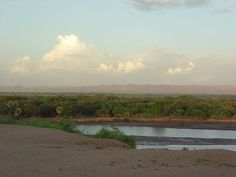 Kerio River flowing after heavy rainstorm. (Rift Valley Province, Kenya.)