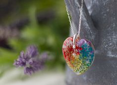 This beautiful necklace is filled with flowers to form an explosion of rainbow colours... each flower has been set in jewellery grade resin, in several stages to minimise bubbles, and each flower has been sealed so they permanently keep their gorgeous colours. The pendant itself is