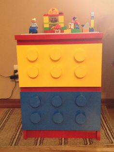 Materials: Malm 2 drawer chest, large dowel, spray paint, Lego base plate, glueDescription: I was looking to make my grand-daughter a Lego table.  The ones I sa