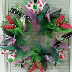 Watermelon Wreath  **twists will be trimmed  Measures approximately 22 X 6 Deep  Handmade in smoke free home with Deluxe Mesh Base, Pink, Lime Green, Black & Emerald Green Deco Mesh, Ribbon, Deco Flex Tubing and a Wire Wreath. Sure to stand out and look Beautiful on any door.  Please contact me with requests  May pick up if local to save on shipping costs