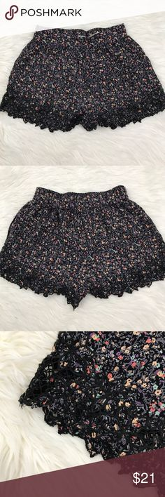 Urban Outfitters Kimchi Floral Embroidered Shorts Urban Outfitters Kimchi blue purple and black Floral mini shorts with pops of yellow and red. Elastic backing on the waist, and Embroidered hem. Waist: 25 inches, inseam 2 inches Rise: 11 inches Urban Outfitters Shorts