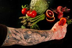 Chef Bruce Kalman of Urbano Pizza Bar in downtown Los Angeles displays his unfinished tattoos of vegetables and fruit.