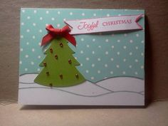 """""""Joyful Christmas"""" -this could be a super cute idea to recreate for a scrapbook page background by using a blue and white polka dot paper for the background paper and then embellishing with a hand cut and hand drawn snow bank and a die cut of a Christmas tree adorned with colored beads or brads and then add photos to layout as desired"""
