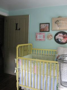 vintage crib painted yellow.