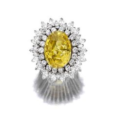 A diamond and yellow sapphire ring