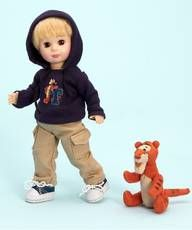 "$67.96 ""T"" is for Tigger 8"". All ready for a day of fun and adventure, this little guy is an 8"" special sculpt Jack doll dressed in his navy hooded sweat jacket with ""T"" and Tigger stamped on front. He wears tan cargo pants and tennis shoes, and is accompanied by a mini plush jointed Tigger all set for a day of bouncing! ""The most wonderful things about Tiggers...."". From Madame Alexander's Disney collection."