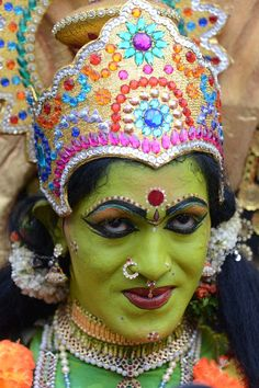 """""""An Indian artist dressed as Hindu Goddess MahaKali performs while in a trance during the final procession of the eleven-day traditional festival of 'Bonalu', a ritual offering to the goddess MahaKali, at Sri Akkanna Madanna Mahankali Temple in Hyderabad on August 5, 2013. The Goddess is honoured mostly by women during Bonalu festival with offerings of food and dancing."""" (Noah Seelam/AFP)"""