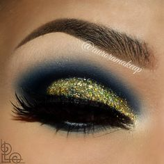 Blue and glitter compliment each other in this bold look perfect for your next night out. See what products she used for a perfect eyeshadow blend and glitter.
