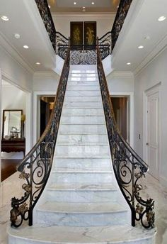 Marble staircase with iron railing. Exquisite!