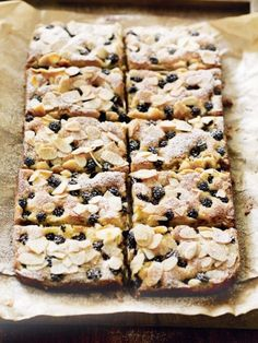 For the ultimate teatime treat, try these blackberry almond bars; sweet shortcrust pastry topped with a frangipane mixture, jam and sweet blackberries. Tray Bake Recipes, Snack Recipes, Cooking Recipes, Snacks, Bar Recipes, Fruit Recipes, Sweet Recipes, Dessert Recipes, Desserts