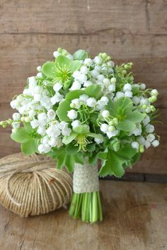 Wedding bouquet of lily of the valley, hellebore & alchemical mollis