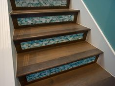 A nod to Spanish Colonial style and the tradition of cladding stair risers with Talavera tiles, glass tile lends color, texture and protection against scuff marks in HGTV Smart Home Tiled Staircase, Tile Stairs, Staircase Design, Staircases, Stair Design, Wood Stairs, Mosaic Stairs, Basement Stairs, Deco Turquoise