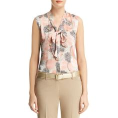 $39.00 A little bit of peach but the look is really nice under a blazer. Tie front sleevless blouse