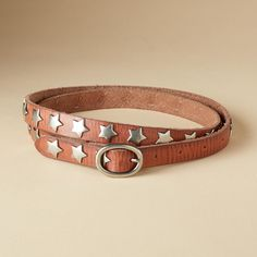 Stars Aligned Belt  Shine on with a skinny leather belt studded with silver stars.