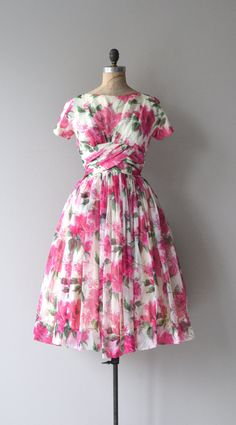 Vintage 1950s, early 1960s Gigi Young airy chiffon dress with big hot pink rose print, bateau neckline, short sleeves, cummerbund wrapped waist, full layered skirt and metal back zipper. ✂-----Measurements  fits like: medium bust: 38-40 waist: 30 hip: free length: 45 brand/maker: Gigi Young condition: excellent  ✩ layaway is available for this item  To ensure a good fit, please read the sizing guide: http://www.etsy.com/shop/DearGolden/policy  ➸ More vintage dresses ✩…