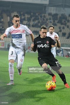 Emanuele Giaccherini # 17 of Bologna FC ( R ) competes the ball with Gaetano Letizia # 3 of Carpi FC ( L ) during the Serie A match between Carpi FC and Bologna FC at Alberto Braglia Stadium on October 24, 2015 in Modena, Italy.