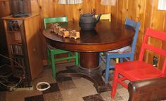 Beautiful antique table with brightly painted side wooden chairs