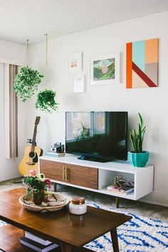 love the retro throwback + colors of this living room #greenery #plants #70s #inspiration
