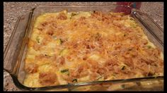 ZUCCHINI CASSEROLE   2 c croutons 1/2 water 1 can cream of mushroom 1/2 c sour cream 2 med zucchini, diced 6 to 8 cups 1/4 c shredded carrot 2/3 c shredded Cheddar cheese salt & pepper  Mix croutons & water. Reserve 1/2 c crouton mix Place 1.5 c of  mix  in the bottom of a 9 x 9 dish.  Mix soup, sour cream, zucchini, mushrooms, carrot & cheese. Spread over stuffing mixt & sprinkle w/ remaining 1/2 c of stuffing mix. Bake for 40 minutes or until hot.