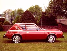 AMC Gremlin.  This was the first car that I owned.  Mine was dark green with the white stripe.  Look at the white wall tires.