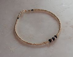 Simple seed bead bracelet with gold plated lobster clasp simple dainty stackable modern friendship bracelet with black accents by MaximumJewelryDesign on Etsy