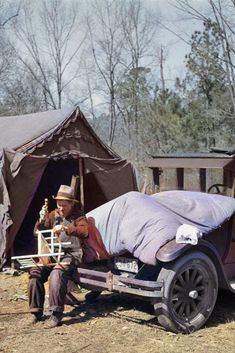 This man, living in a migrant camp near Birmingham, Alabama during the Depression, is making chairs to sell to tourists. Colorized by Steve Smith