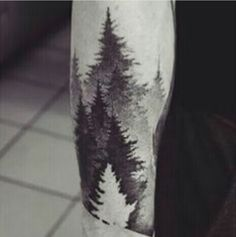 Negative space forest tattoo