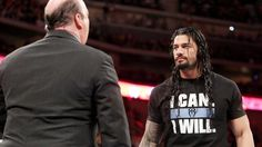 3-16-2015 Raw Roman Reins Tells Paul Haman He Dos'nt Hold Anything Agenced Him He'll Talk To Brock Lesner On Camera