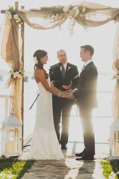 burlap wedding ideas - burlap and flower wedding arch