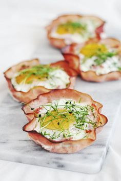 HAM MUFFINS – Bake ham in a cupcake sheet tray — but only after cracking in fresh eggs. Garnish with dill and pepper before enjoying this flavorful, low-carb treat. Click through for the entire gallery and for more easter brunch ideas.