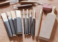 Various stropping devices for sharpening spoon carving tools as well as flat carving knives.
