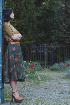 sweater + plaid skirt