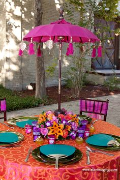 I wanted something bold and colorful and thought of this Baliwood design myhautewedding.com