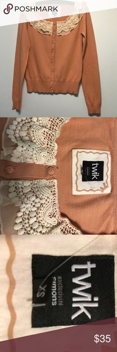 Chic peachy/creamy cardigan with ivory ruffles. Cutest and chicest top around! Adds that girly flair to your jeans and is the perfect color to welcome the spring in! Size XS. Worn once. Looks brand new. Twik Sweaters Cardigans