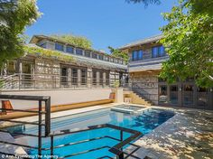 Steven Spielberg's 7,237-square-foot Craftsman-style home boasts seven bedrooms, nine bathrooms, and a two-bedroom guest house, and sits on 1.08 acres with 130 feet of beach frontage