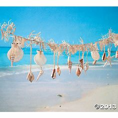 I must have this Shell Garland for the Wedding Party Table!