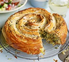 - Veggie Spiral Pie - with spiced tomato sauce & chopped salad, - filo pastry with rice, spinach and herb-filling