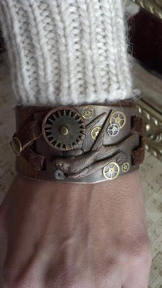 "Unisex Brown leather Steampunk ""Large Diving Sparrow and Gears"" cuff bracelet with moving parts. $35.00, via Etsy."